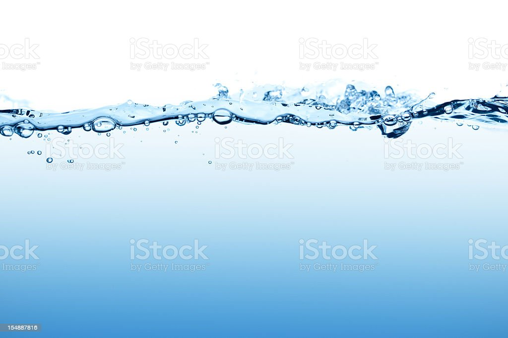 Dynamic blue water surface with bubbles seen at low angle royalty-free stock photo