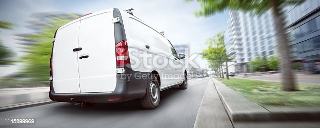 istock Dynamic commercial van driving through the city 1145899969