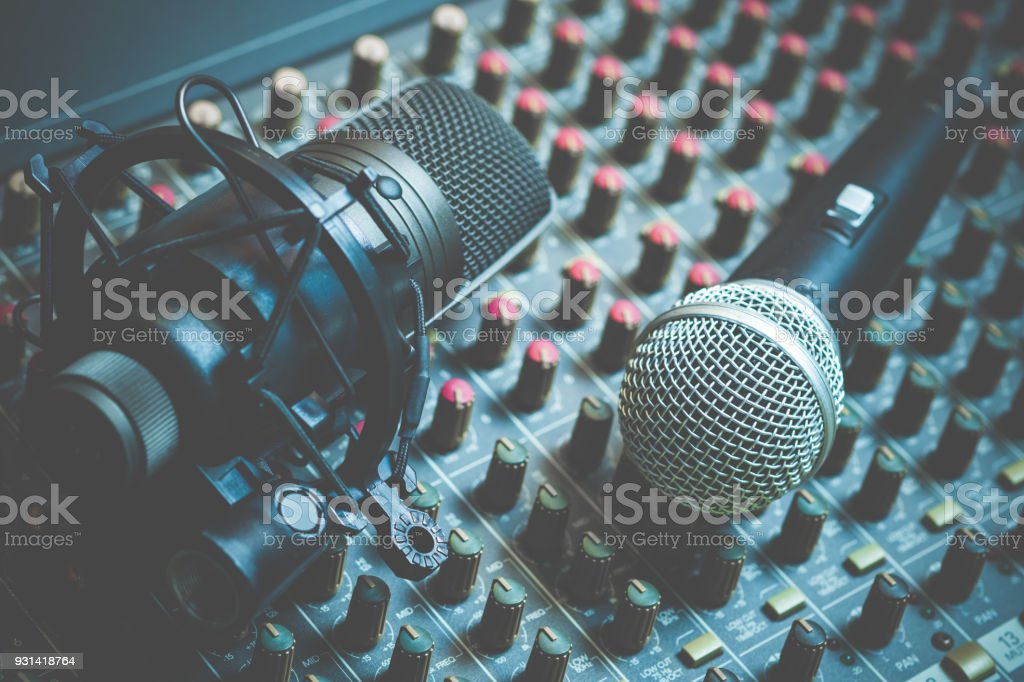 dynamic & condenser microphone on audio mixing console, recording concept stock photo