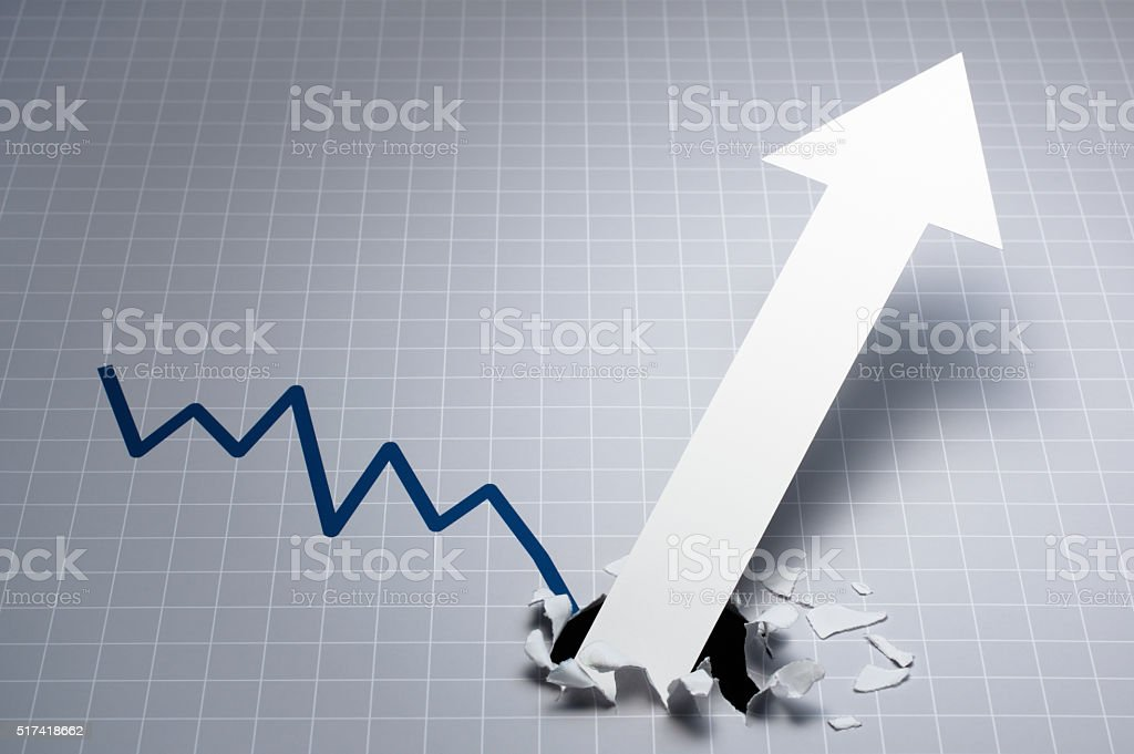 Dynamic growth chart. Upward arrow breaking through the graph. stock photo