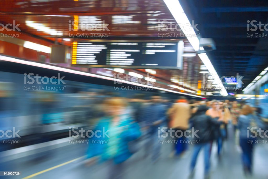 Dynamic photo of people,who are walking in the subway stock photo