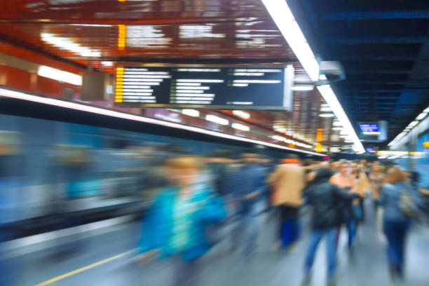Dynamic photo of people,who are walking in the subway Dynamic photo of busy crowd of people who are walking, blurred motion. railroad station platform stock pictures, royalty-free photos & images