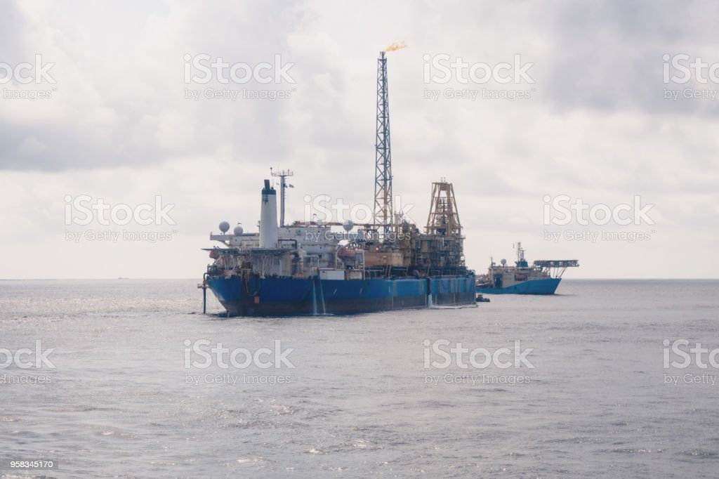 dynamic positioning DP operations near FPSO tanker. Supply fleet job stock photo