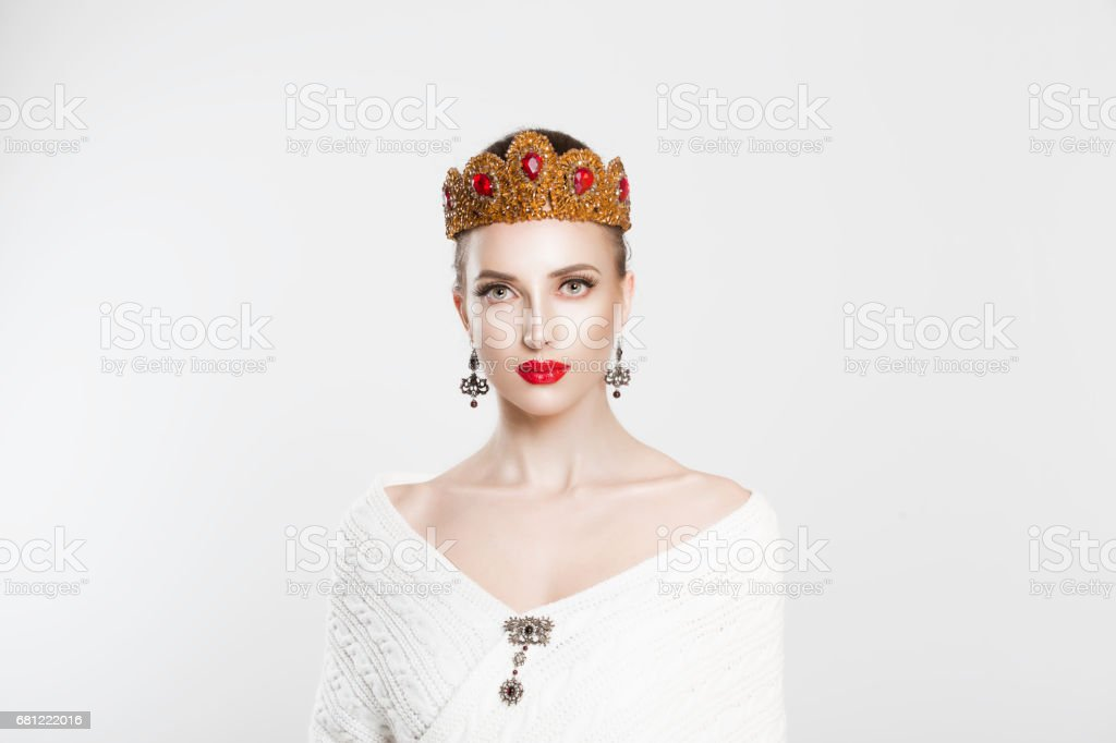 dynamic smiling woman in golden crown with red stones gems crystals...