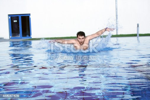 177281231 istock photo dynamic swimmer in pool 453067825
