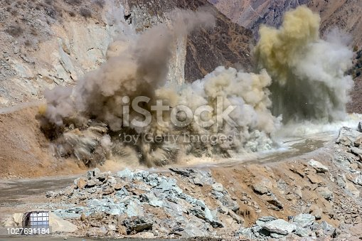 dynamite blasting in road construction at Tajikistan Mountains