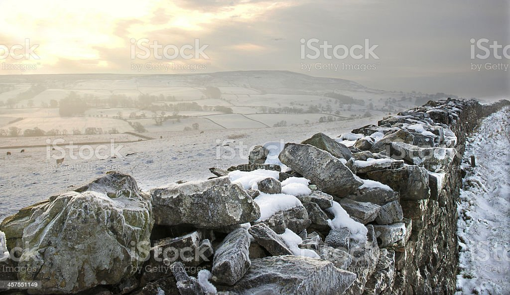 dystone wall in winter stock photo