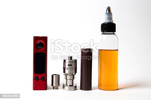 880947556 istock photo e- liquid, e-juice in the bottles and vaping devices isolated on the white background with copyspace 880949980