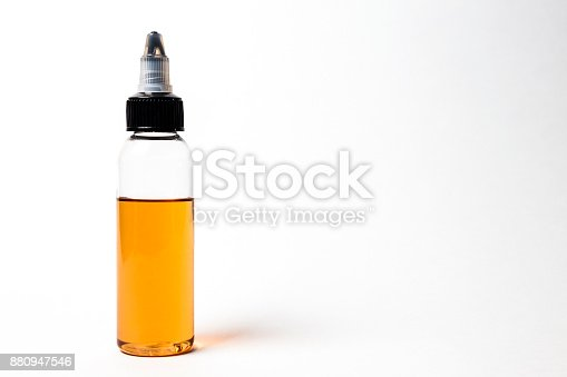istock e- liquid, e-juice in the bottles isolated on the white background with copyspace 880947546