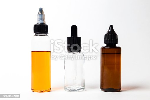 880947556 istock photo e- liquid, e-juice in the bottles isolated on the white background with copyspace 880947558