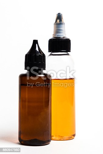 880947556 istock photo e- liquid, e-juice in the bottles isolated on the white background with copyspace 880947560