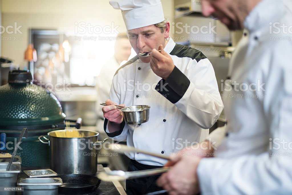 Each meal is checked by the chef stock photo