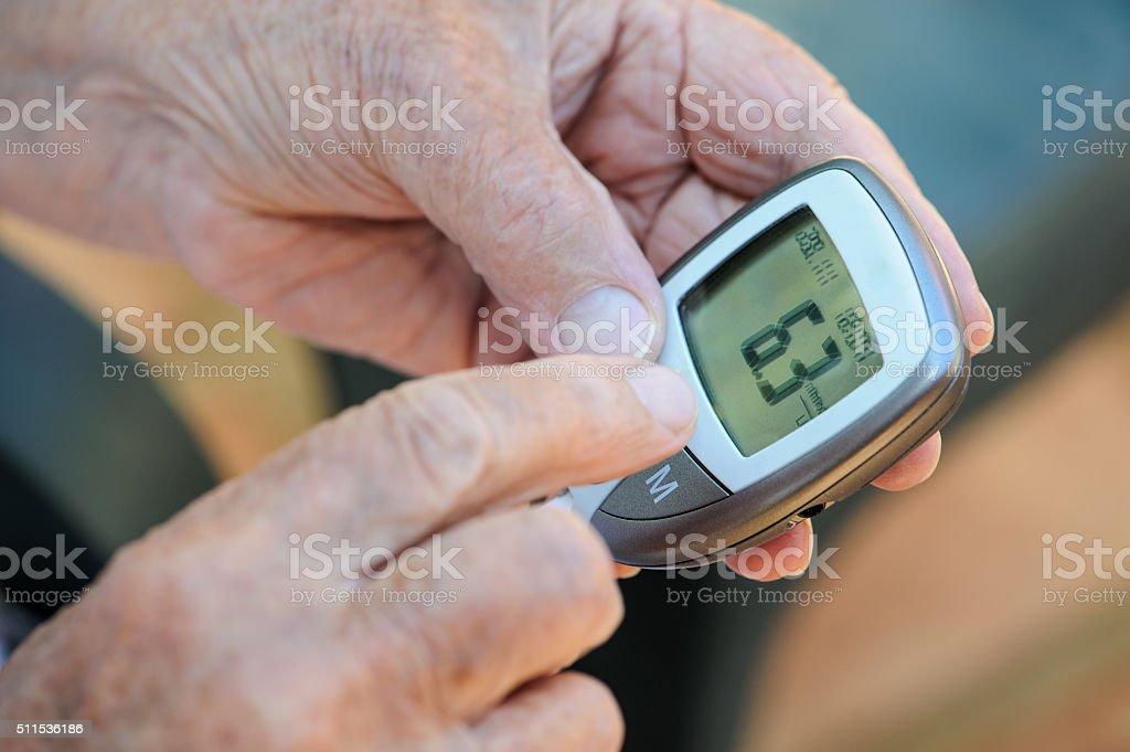 eading blood sugar monitor stock photo