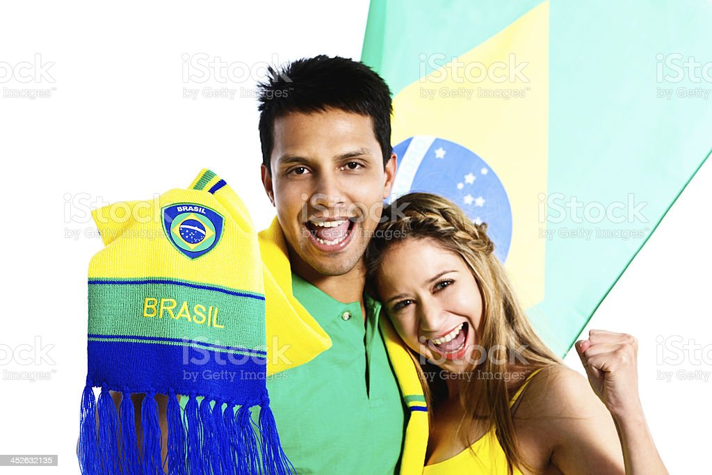 Eager Brazilian soccer fan couple with flag and scarf royalty-free stock photo