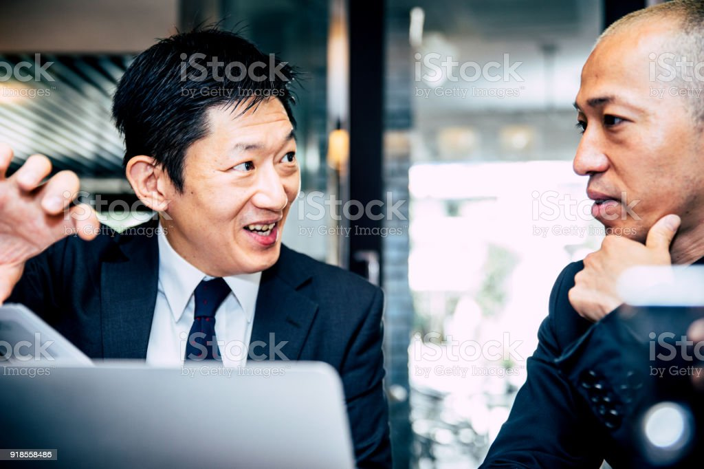Businessman meeting with a restaurant owner in his establishment to...