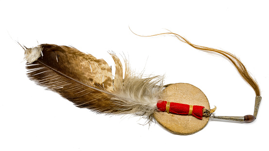 White feather isolated on a black background.