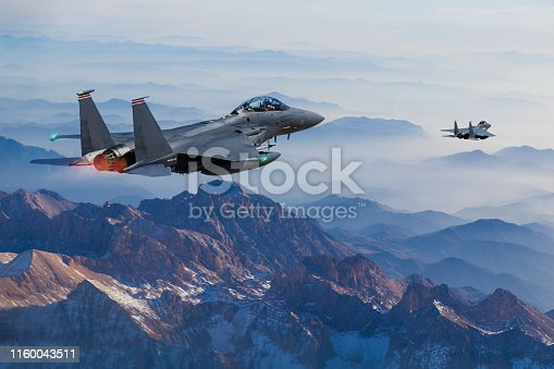 F-15 Eagle Fighter Jets flying above mountains