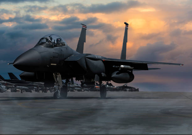 F-15 Eagle Fighter Plane at sunset F-15 Eagle Fighter Plane at sunset military base stock pictures, royalty-free photos & images