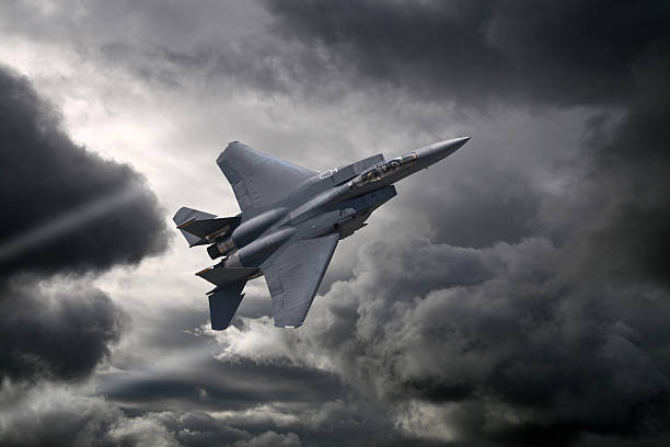 F-15 Eagle flying through the storm F-15 Eagle flying through the storm military airplane stock pictures, royalty-free photos & images