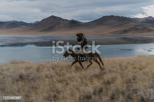 Eagle hunter near the river in Mongolia