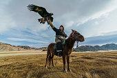 istock Eagle hunter on horse in desert in Mongolia 1221845679