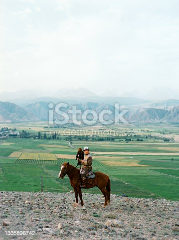 istock Eagle hunter on horse in steppe in Kyrgyzstan 1335896742