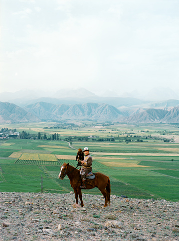Eagle hunter on horse in steppe  in Kyrgyzstan