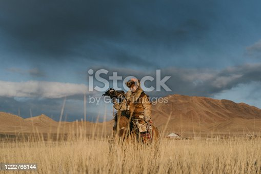 Eagle hunter on horse in steppe  in Mongolia