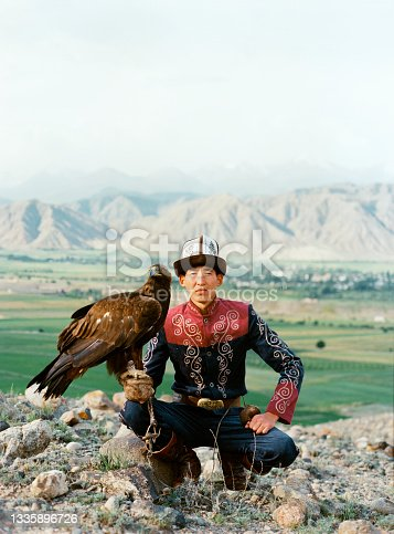 istock Eagle hunter sitting on the background of mountains  in Kyrgyzstan 1335896726