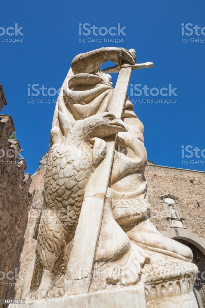 eagle looking in statue of Carlos V in Bisagra Gate Toledo city stock photo