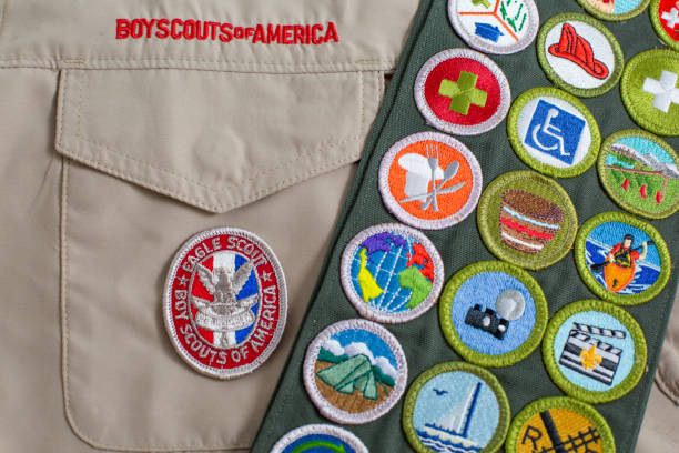 Eagle patch and merit badge sash on boy scout uniform stock photo