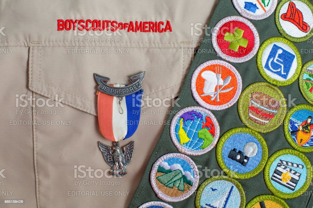 Eagle pin and merit badge sash on boy scout uniform stock photo