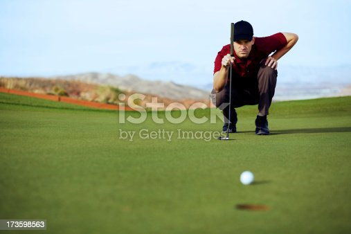 A golfer lines up his eagle putt.