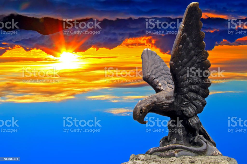 Eagle statue with sunset stock photo