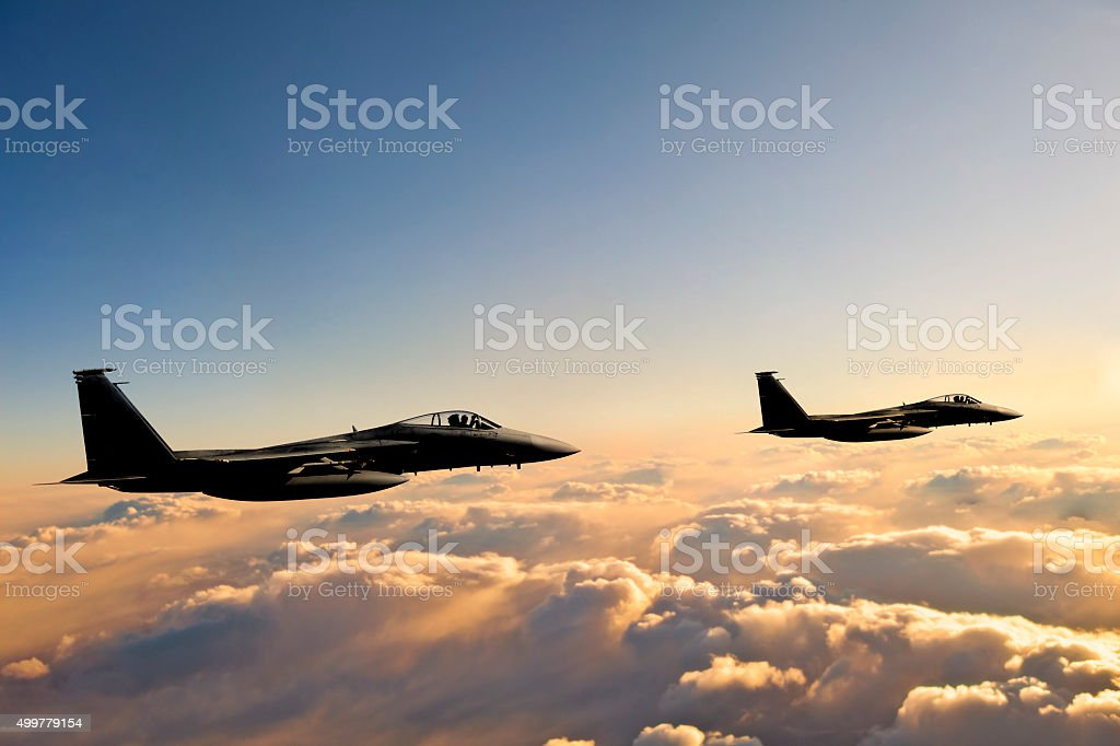 F-15 Eagles in flight at sunset stock photo