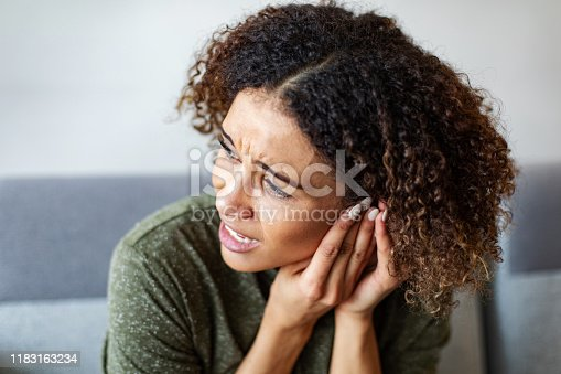 Biracial young woman with an ear ache