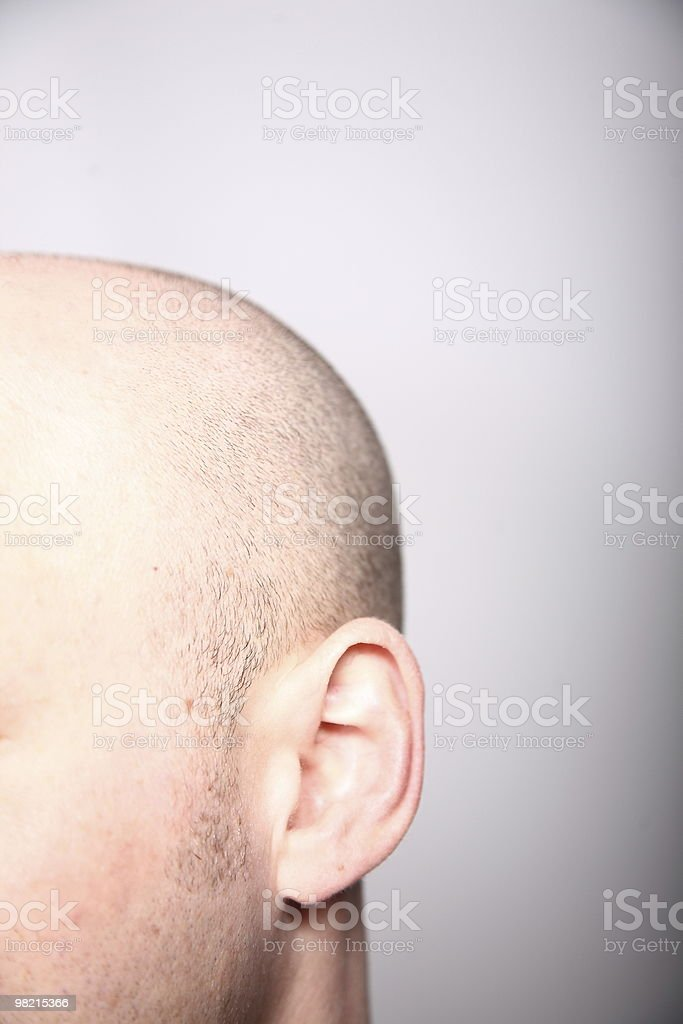 Ear and Skinhead royalty-free stock photo