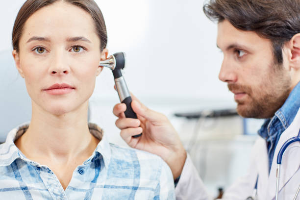 Ear check-up stock photo