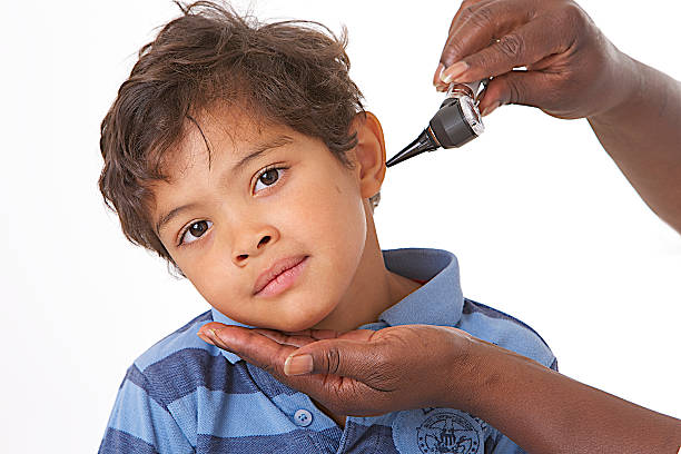 Ear Exam in children stock photo