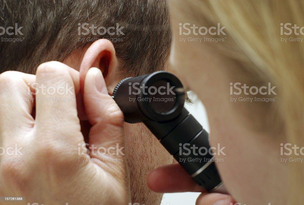 Ear exam royalty-free stock photo