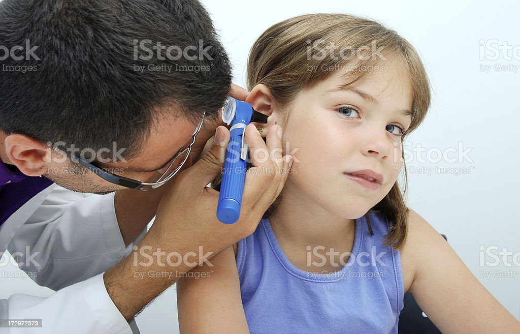 Ear exam with otoscope royalty-free stock photo
