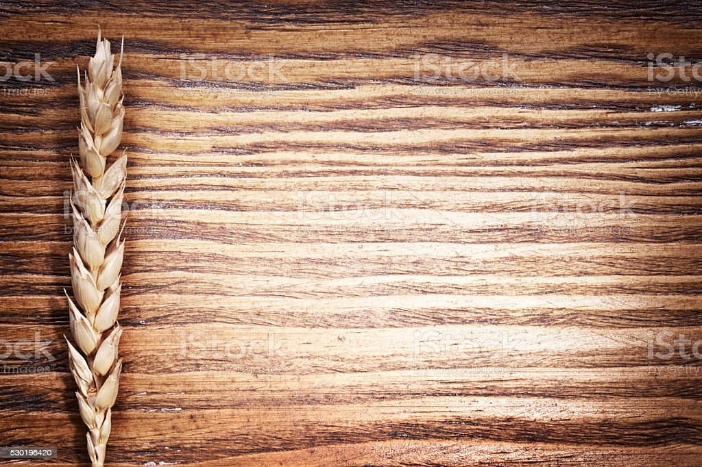Ear of wheat on the wooden table. stock photo