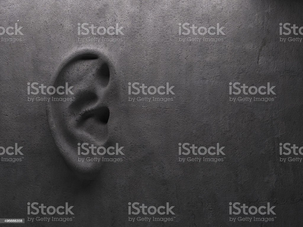 Ear on wall concept stock photo