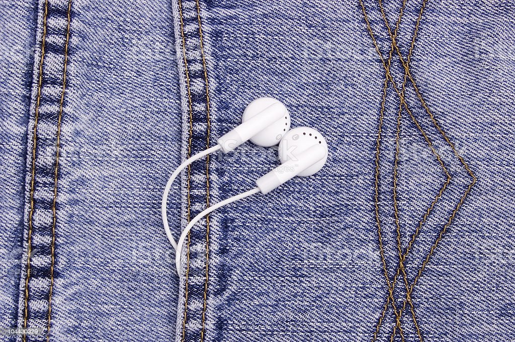Ear phones hanging out of pocket stock photo