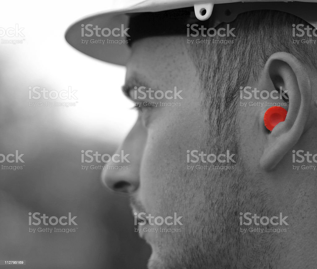 ear protection on a construction worker stock photo