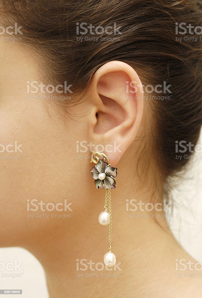 Ear with pearl ear-ring royalty-free stock photo