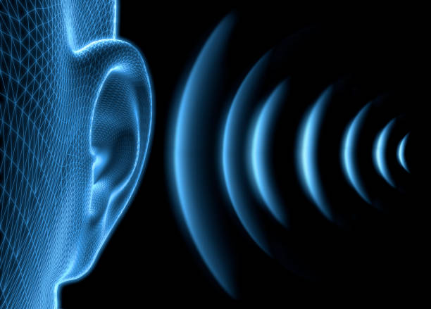 Ear with sound waves stock photo