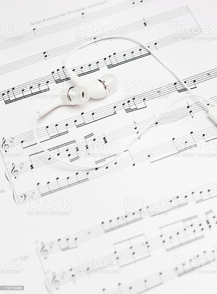 earbuds and sheet music royalty-free stock photo