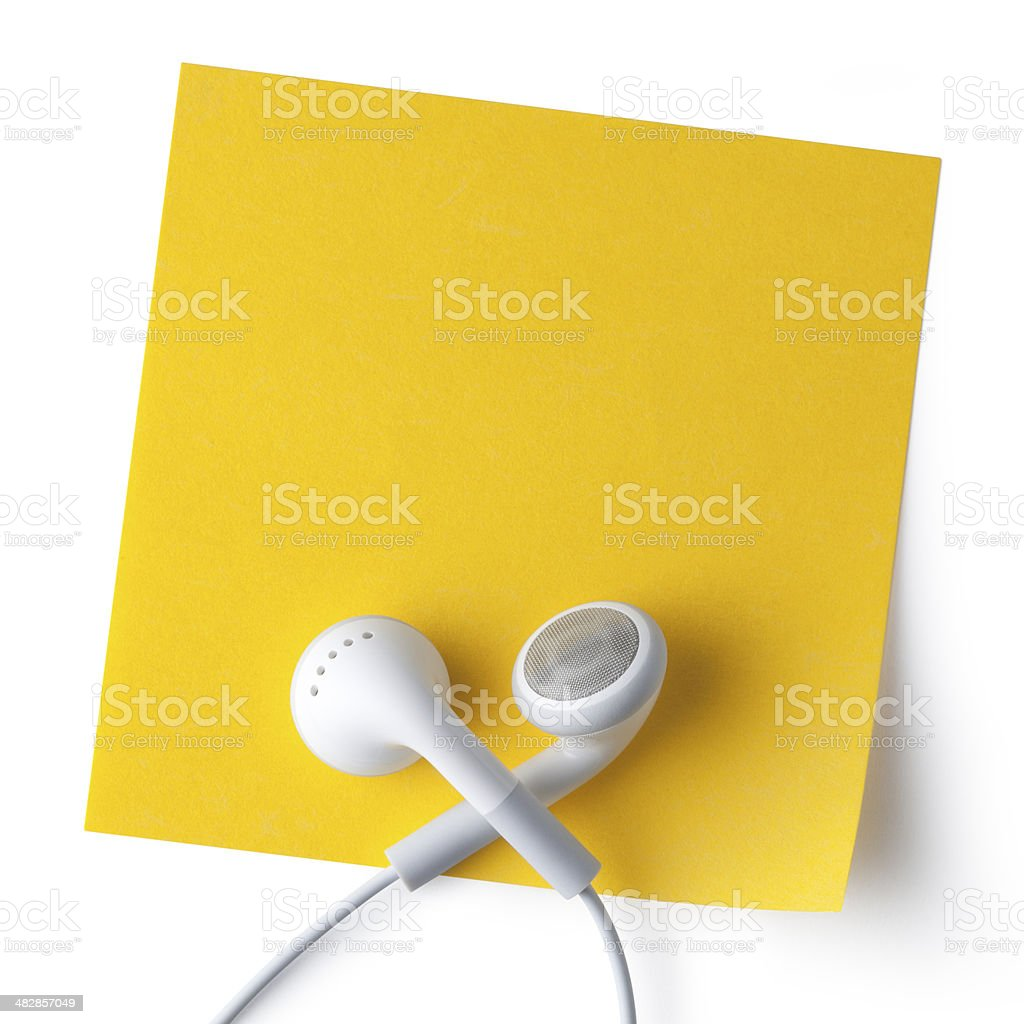 Earbuds on a post it note royalty-free stock photo