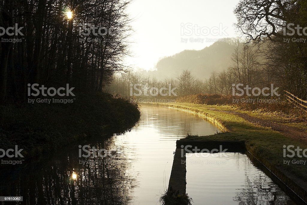 Early autumn morning by a canal royalty-free stock photo